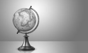 old style globe on gray background