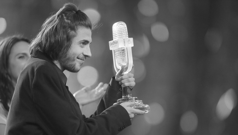 "Salvador Sobral from Portugal celebrates as he holds the trophy after winning the Final of the Eurovision Song Contest with his song ""Amar pelos dois"", in Kiev, Ukraine, Saturday, May 13, 2017. (AP Photo/Efrem Lukatsky)"